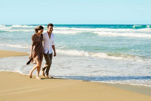 Couple Walking on a Beach at Excellence El Carmen