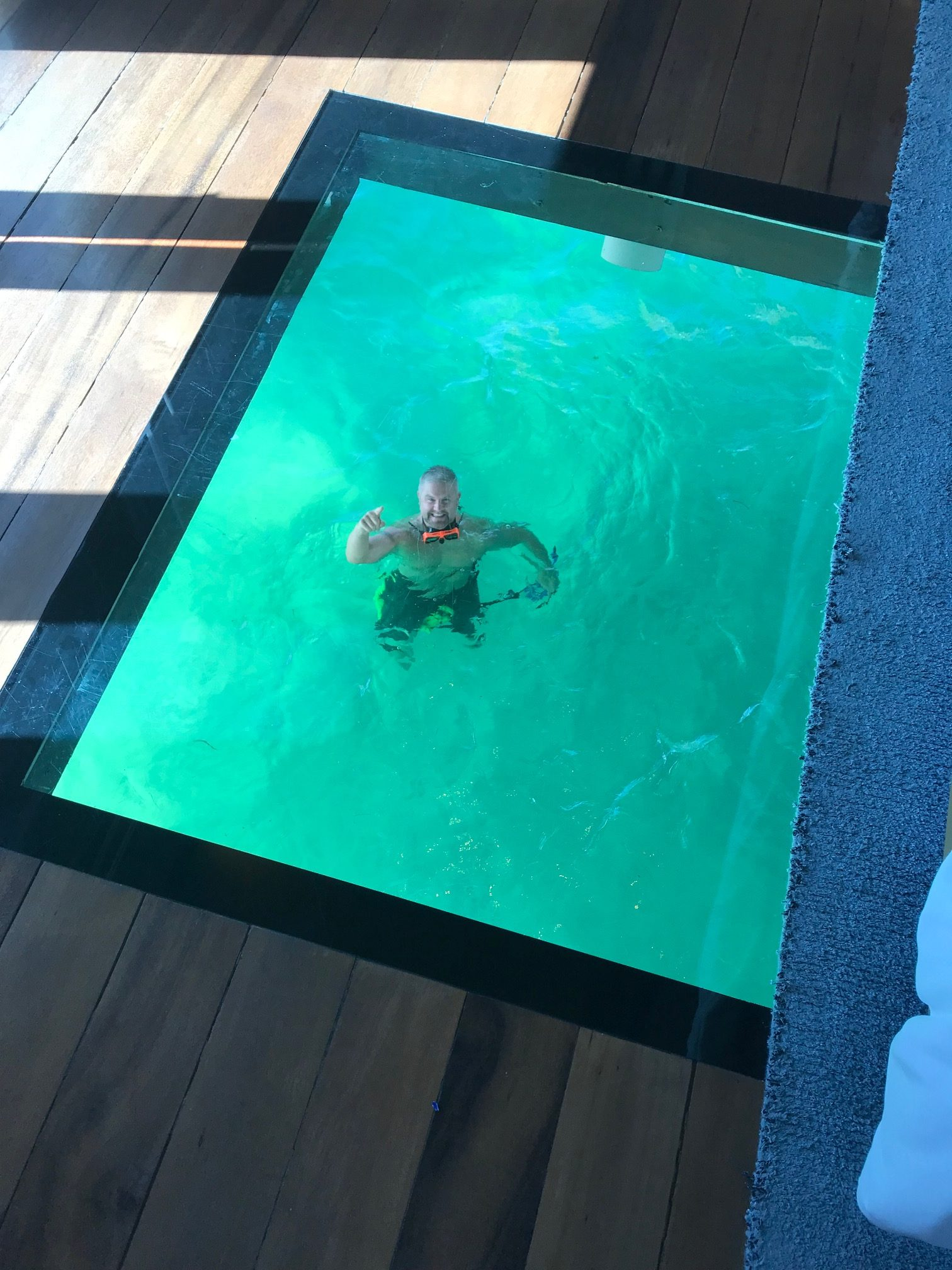 all-inclusive overwater bungalow Glass floors