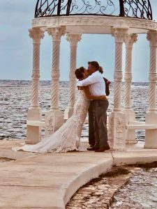 Erica and Joseph's first kiss after getting married at Sandals Royal Caribbean