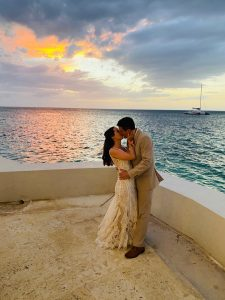 Lindsay and John kiss after getting married at Sandals Montego Bay